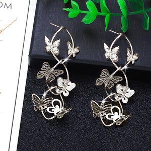 2/$20! Silver Spiraling Butterfly Stud Earrings